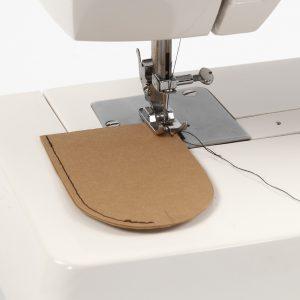 Läderpapper symaskin